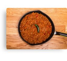 Black Pan of Chili with Jalapeno on Wood Canvas Print