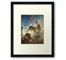 Old farmer burning dead leaves Framed Print