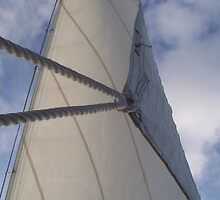 Sail against sky by B. Brannen