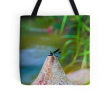 Dragonfly sits on a rock Tote Bag