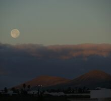 Moon set over the mountains by Allen Lucas