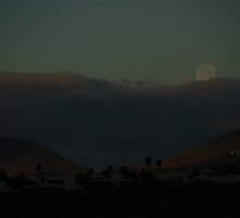 Moon set behind the clouds by Allen Lucas
