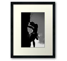 Rock climbing silhouette Framed Print