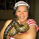 Laurie holding a Boa Constrictor in Ocho Rios, Jamaica by Laurie Puglia