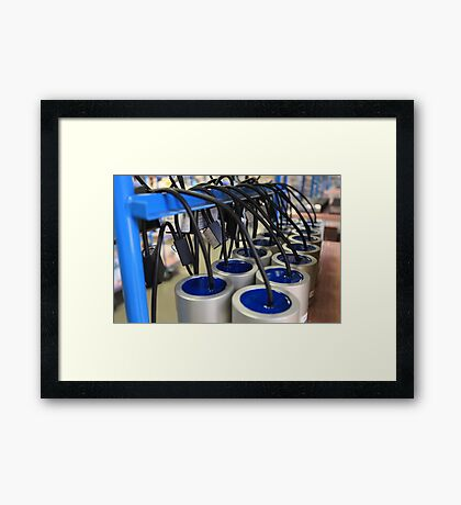 row electronic equipment in manufacturing Framed Print
