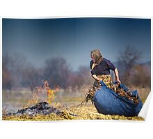 Senior rural woman burning fallen leaves Poster