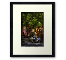 The Blue Scooter Framed Print