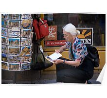 Picking up a postcard Poster