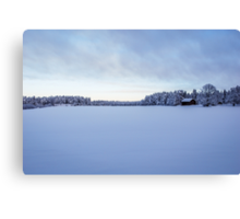 As snow covers the land Canvas Print