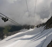 Mount Marmolada in northeastern Italy. The highest mountain of the Dolomites The Cable car  by PhotoStock-Isra