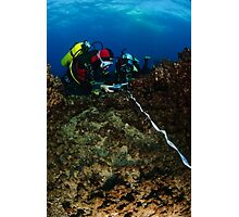 professional Scuba divers perform an underwater survey of the Mediterranean seabed  Photographic Print