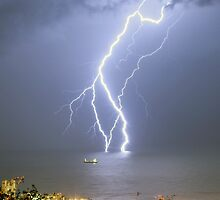 Lightning strikes the Mediterranean Sea.  by PhotoStock-Isra