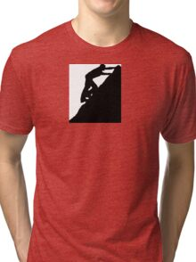Silhouettes of a man climbing a rock Tri-blend T-Shirt