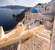 At the steps of Oia by Yannis Larios