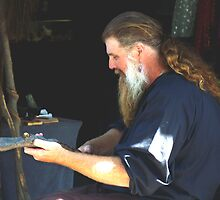 Carving a Walking Stick  by Judi Taylor