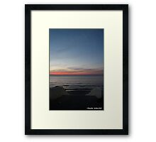 Sunset at sea with stairs Framed Print