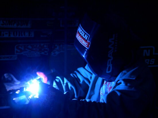 Me taking a shot at welding  by Rachel Counts