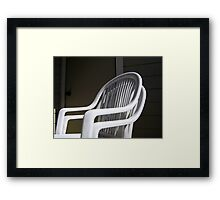 THE original White Plastic Chairs Framed Print