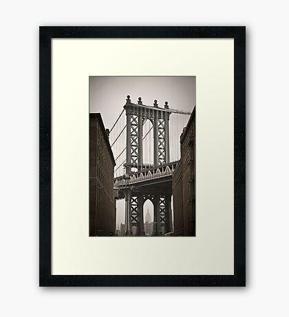 Empire State Building through arch of Manhattan Bridge Framed Print