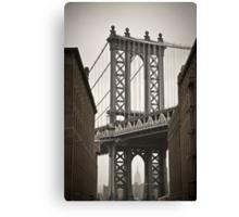 Empire State Building through arch of Manhattan Bridge Canvas Print