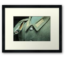 button on a soldier's uniform Framed Print