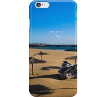 EMPTY BEACH AND STACKED SUNBEDS. iPhone Case/Skin