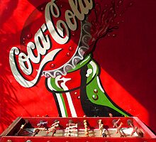 Coca Cola Ad with red table football by Guy C. André Tschiderer