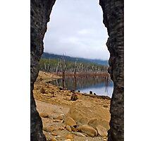Lake Mackintosh through the eye of a burnt-out Stump. Photographic Print
