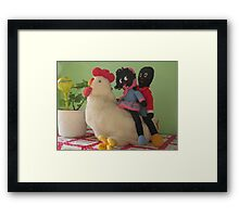Gollies riding a Chicken Framed Print