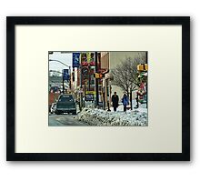 A Snowy Day in Town Framed Print