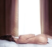 Woman sleeping nude in bed by the window art photo print by ArtNudePhotos