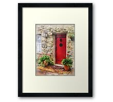 Geraniums by Red Door Framed Print