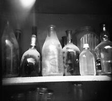 dusty bottles by Diego M. Apud