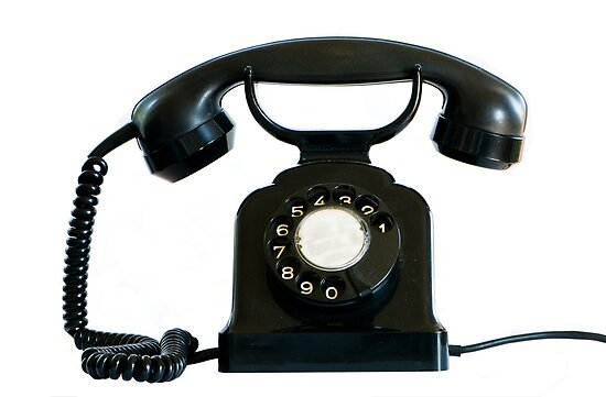 Old black phone isolated on white.   by peterwey