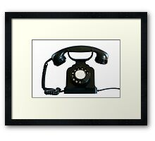 Old black phone isolated on white.   Framed Print