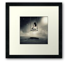 sureal/conceptual scenery of young girl on swing  Framed Print