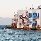 couple sits in iconic Mykonos, Greece by tara romasanta