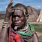 TRIBAL LADY - ETHIOPIA by Michael Sheridan