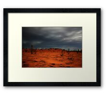 Red dirt.  Black Clouds. Framed Print