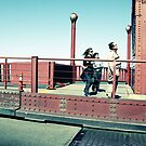 Tourists on the Golden Gate bridge by Kiny McCarrick