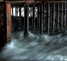 Tide Against the Pier (1 of 3) by Kevin Baker