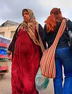 Crossing Paths. A Muslim and Jewish women at the Nazareth  open market, Israel by Eyal Nahmias