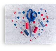 Sewing kit on a wooden table Canvas Print