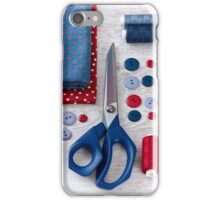 scissors, threads, fabric and buttons on wooden table iPhone Case/Skin