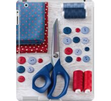 scissors, threads, fabric and buttons on wooden table iPad Case/Skin