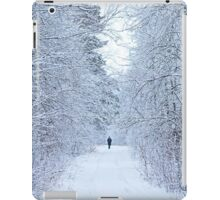frozen winter road on the forest with along person iPad Case/Skin