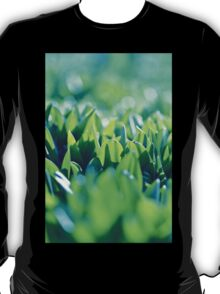 Natural green background with selective focus under the sun T-Shirt