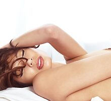 Beautiful young woman lying topless in bed clsoeup of face art photo print by ArtNudePhotos