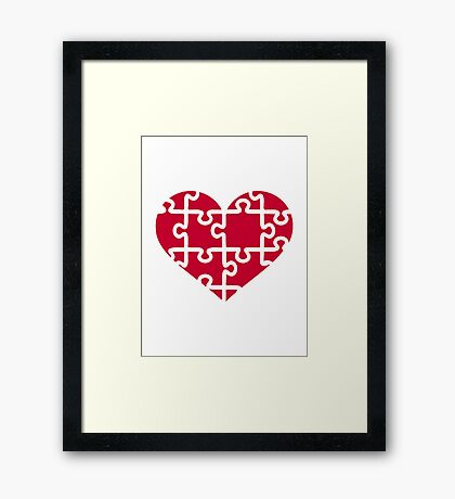 Red heart puzzle Framed Print