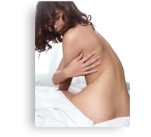 Artistic portrait of beautiful nude asian woman sitting on a bed art photo print Canvas Print